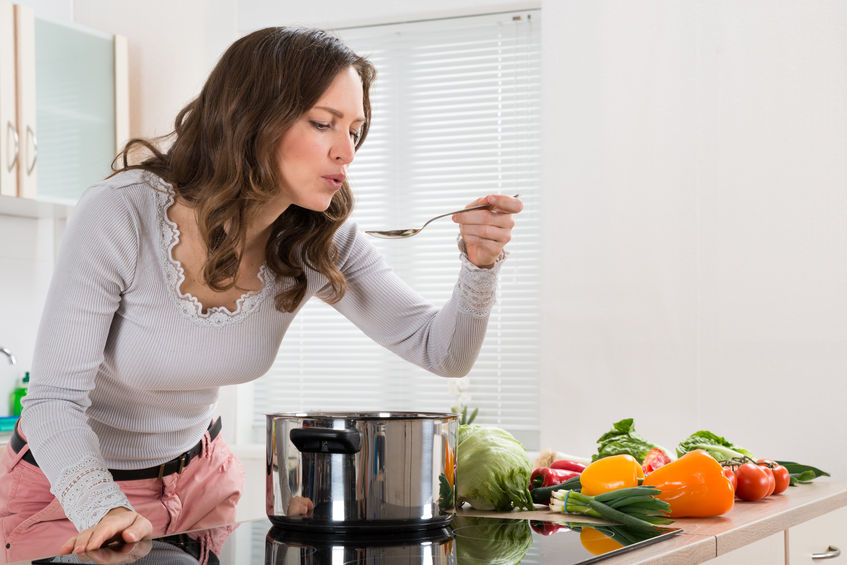 woman-tasting-from-electric-pressure-cooker-or-pot